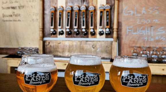 This is an image of Shacklands Brewing Co. on the Craft Beer Passport website. Get a $2 craft beer here using the Craft Beer Passport app!