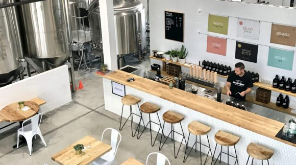 This is an image of the Grain & Grit Brewing Taproom. Get a $2 craft beer here using the Craft Beer Passport app!