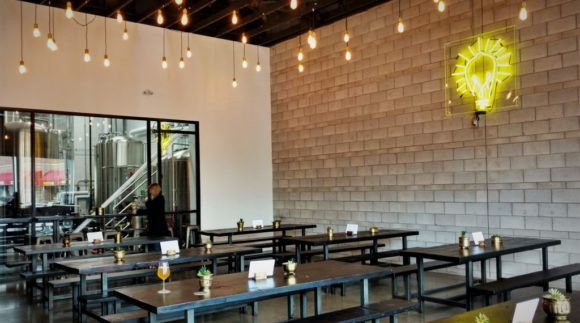 This is an image of the Merit Brewing Taproom. Get a $2 craft beer here using the Craft Beer Passport app!