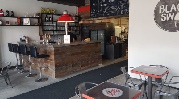 This is a photo of Black Swan Brewing. Get a $2 craft beer here with Craft Beer Passport app.