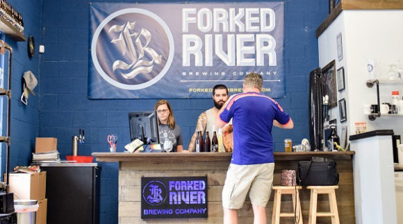 This is a photo of Forked River Brewing's taproom. Get a $2 craft beer here with Craft Beer Passport app.